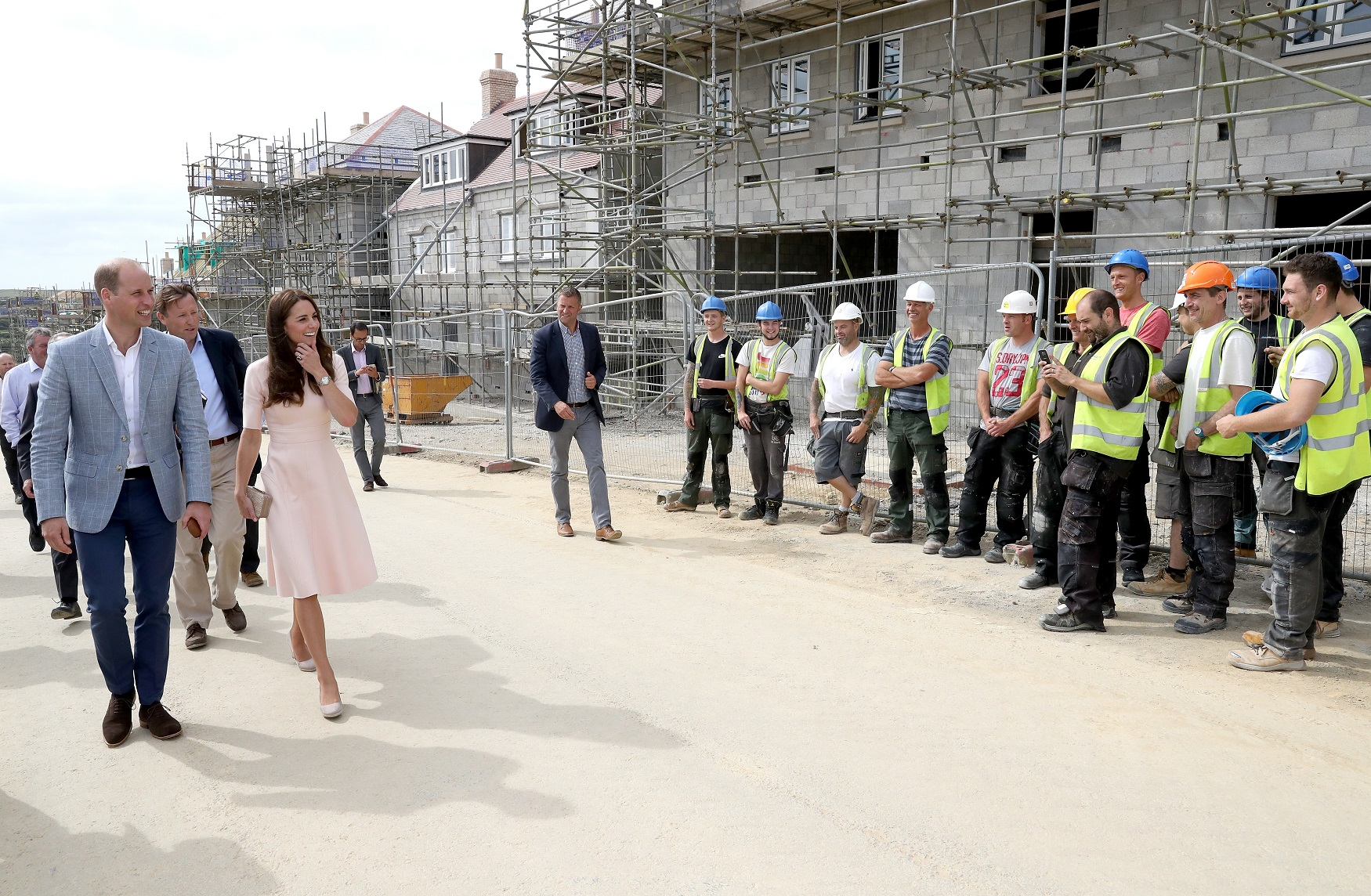 NEWQUAY, ENGLAND - SEPTEMBER 01: Prince William, Duke of Cambridge and Catherine, Duchess of Cambridge share a joke with construction workers as they visit Nansledan, a 218-hectare site that will provide future business and housing for the local area on September 1, 2016 in Newquay, United Kingdom. (Photo by Chris Jackson - WPA Pool/Getty Images)