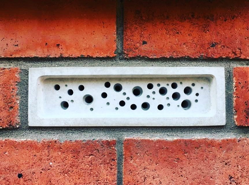 Photograph of a bee brick