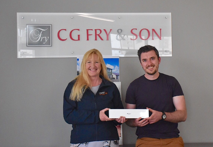 Prize draw winner picks up new watch - and a new house