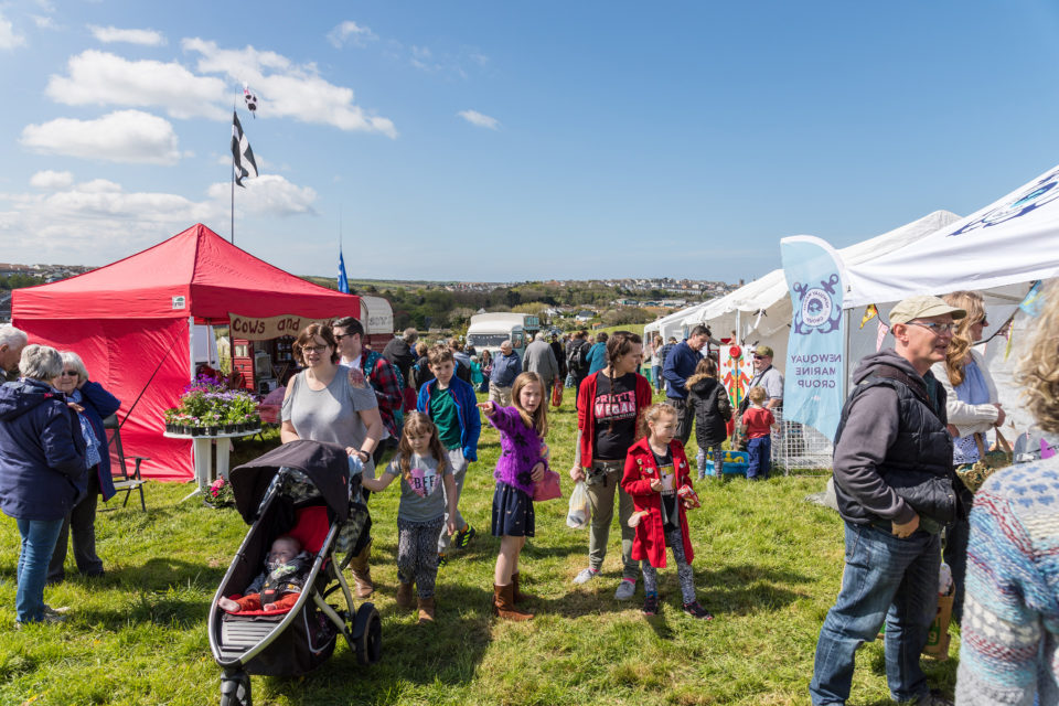 Photo of people at the Newquay Community Orchard Spring Fayre in 2018.