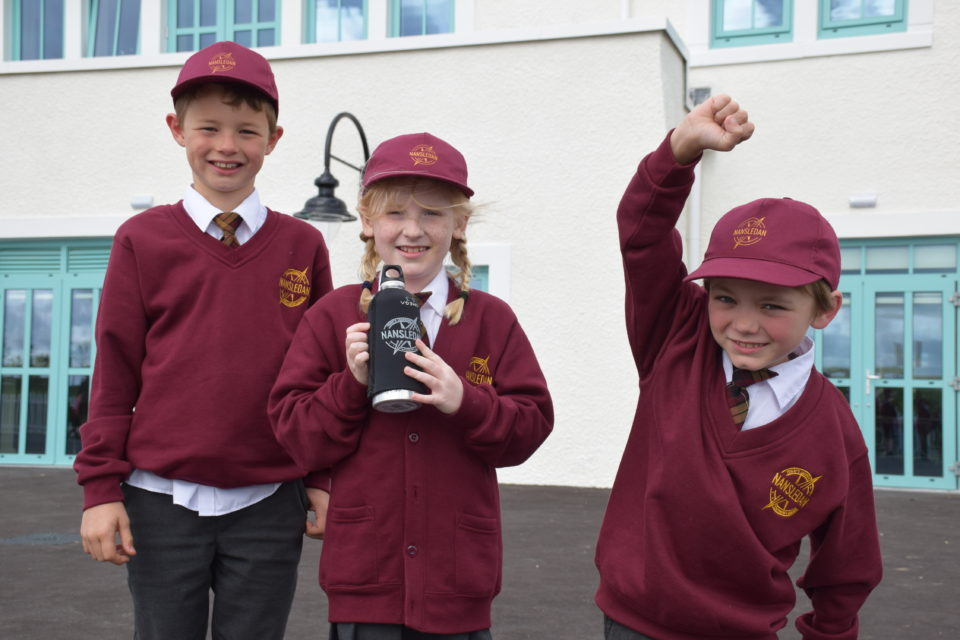 Pupils celebrate the first day of school at Nansledan's new primary school