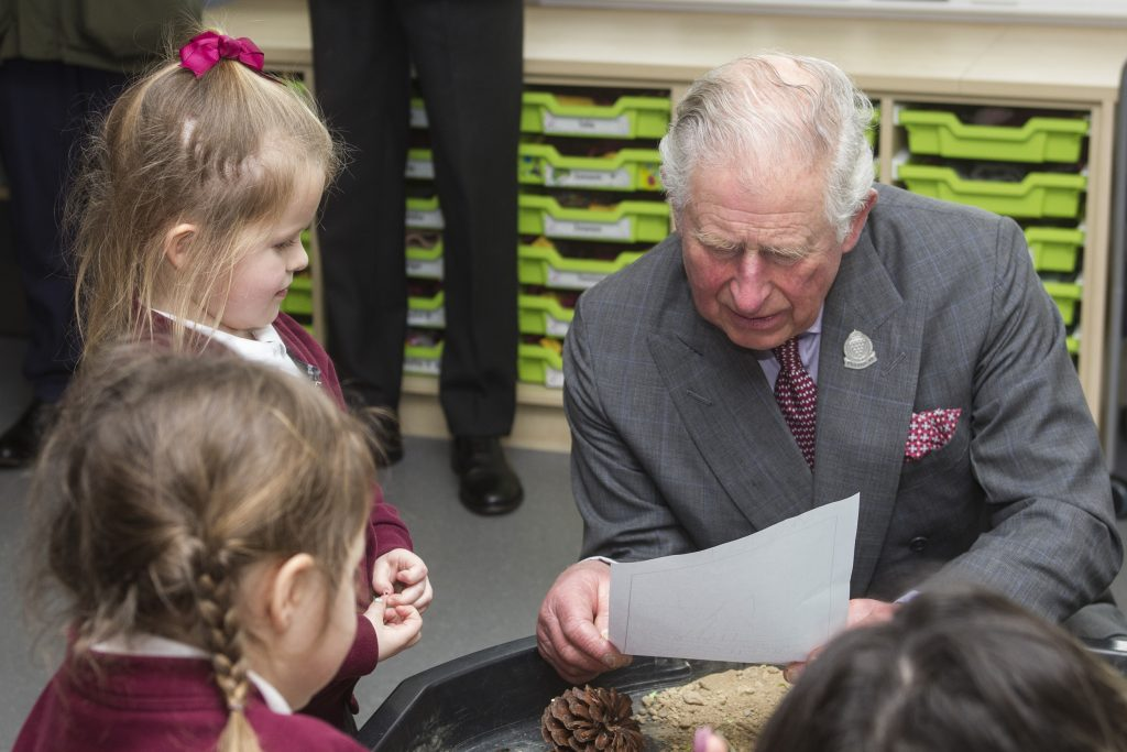 HRH The Duke of Cornwall with children at Nansledan's primary school during a visit in March 2020. The school has won a social impact award.
