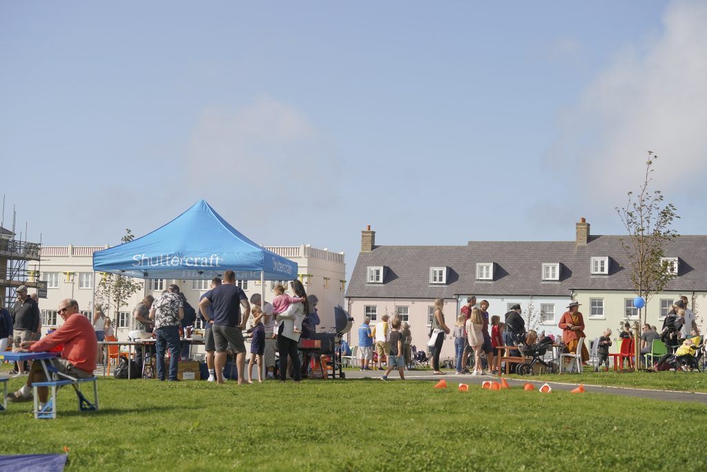 Residents and their families enjoy the Nansledan Community Association Summer Fete and BBQ